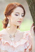 Beautiful women in dress on a spring outdoor. — Stock Photo