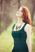 Beautiful women in dress on a spring outdoor. — Stock fotografie