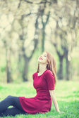Redhead women  in a park — Stock Photo