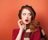 Surprised girl with beret and scarf.  — Stock Photo