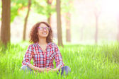 Indian girl with glasses in the park. — Stock Photo