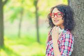 Indian girl with headphones in the park. — ストック写真