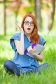 woman in glasses and with notebook  — Stok fotoğraf