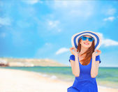 Redhead girl on the beach in spring time. — Stock Photo