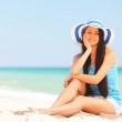 Young brunette girl on the beach. — Stock Photo #46156527