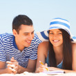 Young students in love on the beach. — Stock Photo #46156651