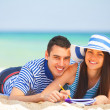 Young students in love on the beach. — Stock Photo