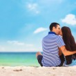 Young couple on the beach in summer day. — Stock Photo