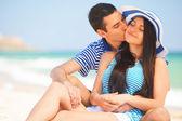 Beautiful couple kissing on the beach. — Stock Photo