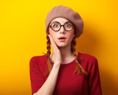 Redhead girl with pigtails on yellow background. — 图库照片