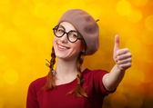 Redhead girl with pigtails on yellow background. — Stok fotoğraf