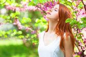 Redhead girl in the garden. — Stock Photo