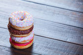 Donuts on wooden table. — Stock Photo