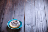 Donut on wooden table. — Stock Photo