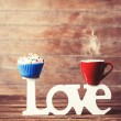 Cupcake, coffee and word Love on wooden table. — Stock Photo #47407909