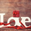 Little gift and word Love on wooden table. — Stock Photo #47407941