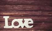 Word love on wooden table. — Stock Photo