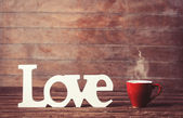 Tea or coffee cup with word Love on woodent table. — Foto Stock