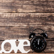 Word Love and alarm clock. — Stock Photo