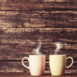 Two cups of coffee on wooden table. — Stock Photo #48061405