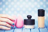 Female hand and beauty blender. — Stock Photo
