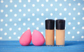 Beauty blender on blue background. — Stock Photo