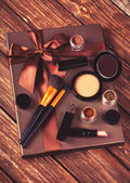Cosmetics and gift box on wooden table. — Stock Photo