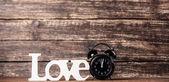 Word Love and alarm clock. — Stock Photo