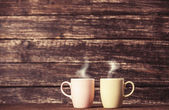 Two cups of coffee on wooden table. — Stock Photo