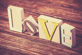 Word love on wooden table. — ストック写真