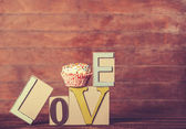 Cupcake and word Love on wooden table. — 图库照片