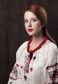Redhead girl in ukrainian national clothing. — Stock Photo