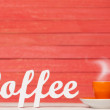Abstract wooden word Coffee with cup on red wooden background. — Stock Photo #48815407