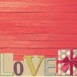 Little gift and word Love on wooden table. — Stock Photo #48815423
