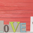 Word Love and frame for photo on wooden table. — Stock Photo #48815427