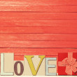 Little gift and word Love on wooden table. — Stock Photo #48815437