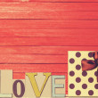 Little gift and word Love on wooden table. — Stock Photo #48815459