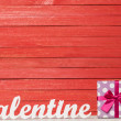 Wooden word Valentine and gift on wooden table. — Stock Photo #48815511