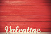 Wooden word Valentine on red background. — Stock Photo
