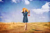 Girl with lamp on country side road. — Stock Photo