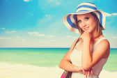 Young girl on the beach in spring time. — Stock Photo