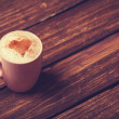 Cup of coffee with shape heart on wooden table. — Stock Photo #50634921