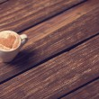 Cup of coffee with shape heart on wooden table. — Stock Photo