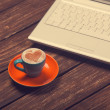 Cup of coffee with heart shape and notebook on wooden table. — Stock Photo #50635213