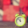 Little alarm clock and gift on background. — Stock Photo #50635435