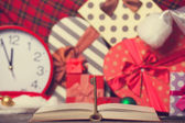 Book and key with chirstmas gifts — Stock Photo