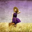 Lonely girl with suitcase at country. — Stock Photo #6448815
