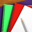 Colorful notebooks ond pencil — Stock Photo