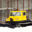 Small yellow snowcat — Stock fotografie