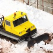 Foto Stock: Small parked snowcat